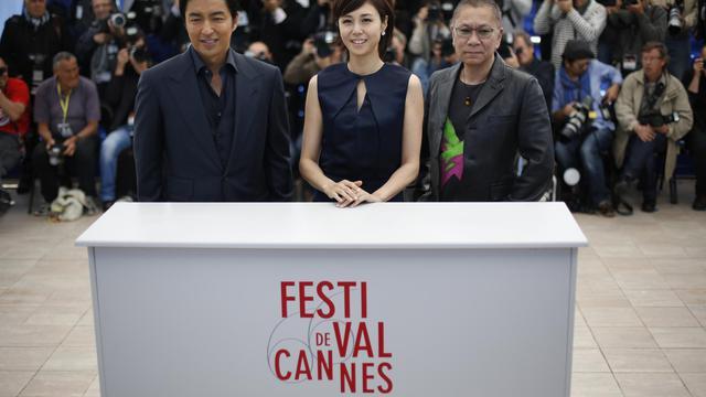 """Le réalisateur du film """"Shield of Straw"""" Takashi Miike (d) et les acteurs Takao Osawa et Nanako Matsushima, le 20 mai 2013 à Cannes [Loic Venance / AFP]"""