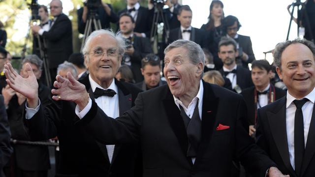 Michel Legrand (à gauche) et Jerry Lewis, sur le tapis rouge de Cannes, le 23 mai 2013 [Anne-Christine Poujoulat / AFP]