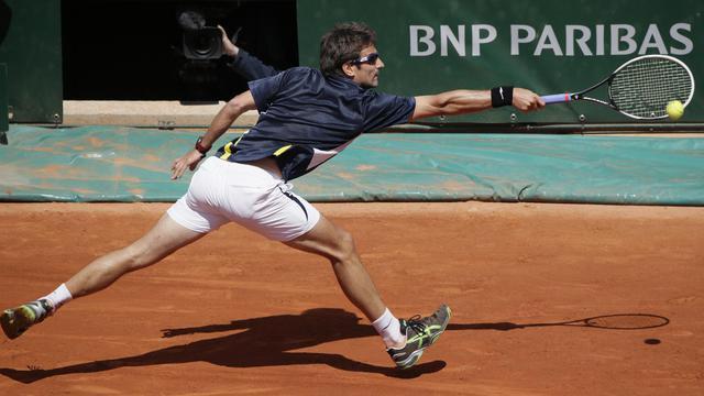 L'Espagnol Tommy Robredo lors d'un match contre Nicolas Almagro à Roland-Garros le 2 juin 2013 [Kenzo Tribouillard / AFP]