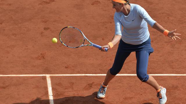 La Bélarusse Victoria Azarenka lors de son match contre Francesca Schiavone à Roland-Garros le 3 juin 2013 [Miguel Medina / AFP]