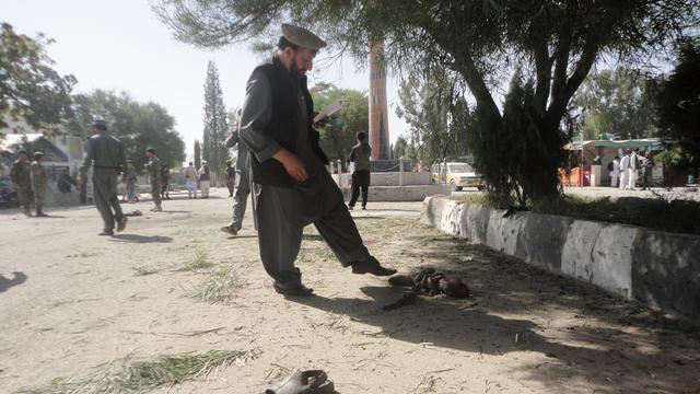 Les restes d'un kamikaze après une attaque suicide le 1er octobre 2012 à Khost, en Afghanistan, qui a fait au moins 14 morts [ / AFP]