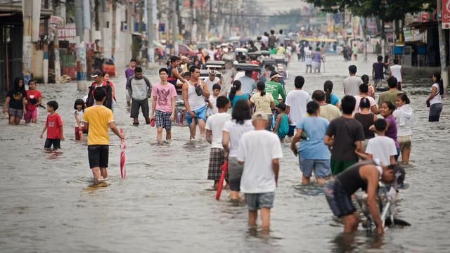 Les pluies diluviennes à l'origine d'inondations monstres cette semaine à Manille ont affecté 2,44 millions de personnes et fait 60 morts, ont annoncé les secours vendredi.[AFP]
