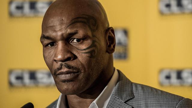 """Le légendaire boxeur Mike Tyson a confié mercredi à Hong Kong vouloir danser et chanter dans des comédies musicales pour faire oublier son passé de """"mauvais garçon"""". [AFP]"""