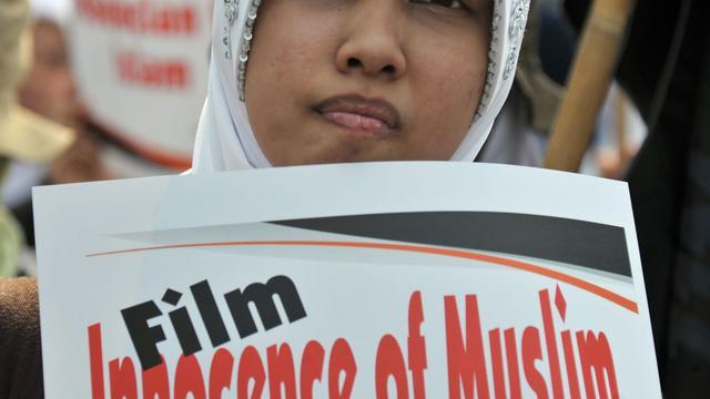 """Une manifestante participe à la protestation contre le film """"l'Innocence des musulmans"""", le 14 septembre 2012 à Jakarta [Bay Ismoyo / AFP/Archives]"""
