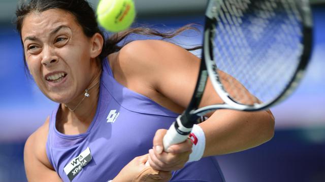 La Française Marion Bartoli face à l'Italienne Sara Errani en 8e de finale du tournoi de Tokyo le 26 septembre 2012. [Toru Yamanaka / AFP]