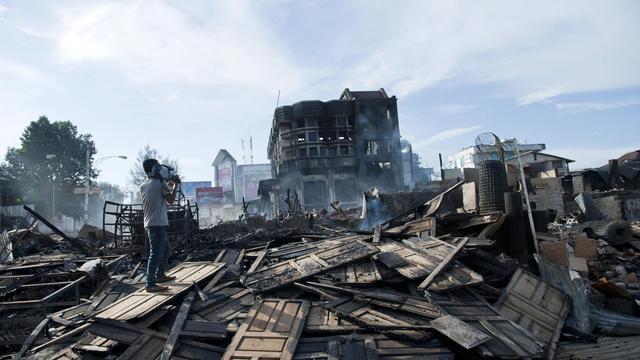 Les restes de maisons brûlées le 29 mai 2013 à Lashio, dans l'état du Shan [Ye Aung Thu / AFP]