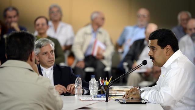 Le président vénézuélien par intérim Nicolas Maduro (D) à Caracas, le 25 mars 2013 [Juan Barreto / AFP]