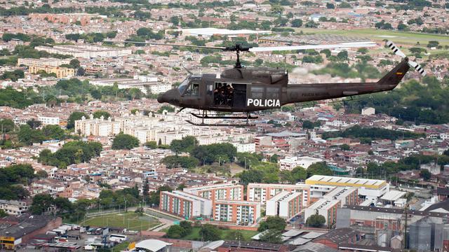 Un hélicoptère survolle la ville de Cali, le 19 mai 2013 [Luis Robayo / AFP/Archives]