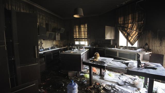 Le consulat américain de Benghazi détruit le 11 septembre 2012 [Gianluigi Guercia / AFP]