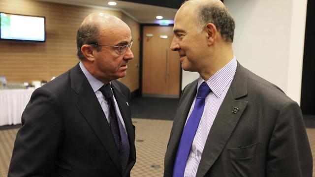 Les ministres des Finances espagnol (g) et français à Chypre, le 14 septembre 2012 [Yiannis Kourtoglou / AFP]