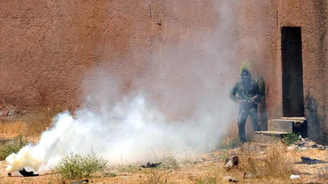 Une photo fournie par l'agence Sana, le 22 mai 2013, montre un soldat syrien lors d'un entraînement en Syrie [ / SANA/AFP]