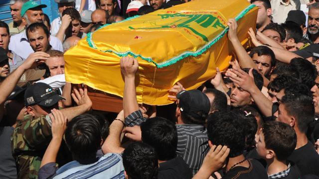 Obsèques le 23 mai 2013 Haret al-Fikani dans la plaine de la Bekaa d'un membre du Hezbollah chiite [- / AFP]