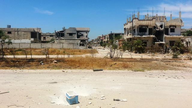 Bâtiments détruits par les combats le 23 mai 2013 à Qousseir [Sarkis Kassargian / AFP]
