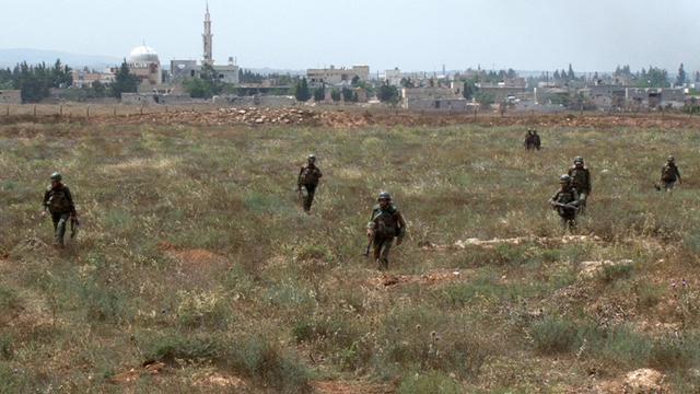 Des soldats d'Assad à Dabaa, au nord de Qousseir, le 30 mai 2013 [ / Sana/AFP]