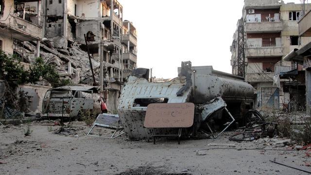 Photo fournie le 6 juin 2013 par le Shaam News Network, prise dans une rue d'Alep [ / Shaam News Network/AFP]