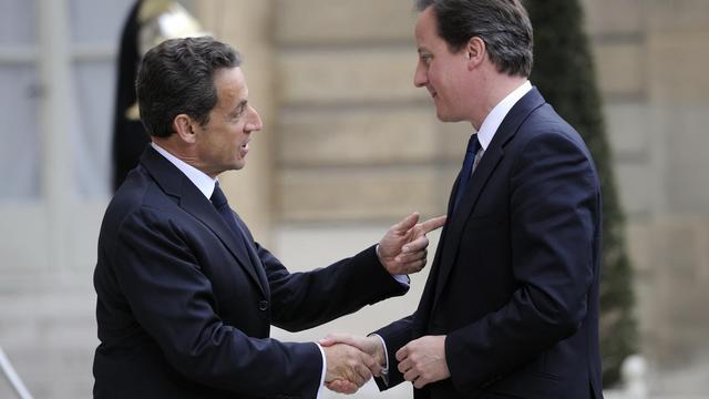 Nicolas Sarkozy accueille David Cameron à l'Elysée, le 13 avril 2011 [Eric Feferberg / AFP/Archives]