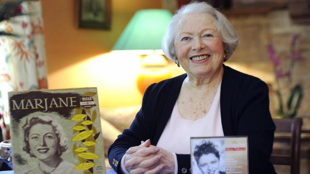 """Elle aura 100 ans le 26 août mais Léo Marjane, vedette de la chanson française des années 40, aujourd'hui retirée dans sa maison de Barbizon, garde une énergie et un enthousiasme débordants, se remémorant """"un succès mondial"""" auquel elle ne """"s'attendait pas"""".[AFP]"""