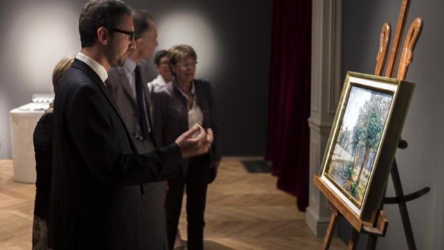 """Un tableau de Francis Picabia, """"La rivière"""", dérobé il y a près de 40 ans au musée de Nevers (Nièvre), a été restitué à la ville par la maison d'enchères Sotheby's qui l'avait vendu de bonne foi à un particulier avant d'apprendre qu'il avait été volé.[AFP]"""