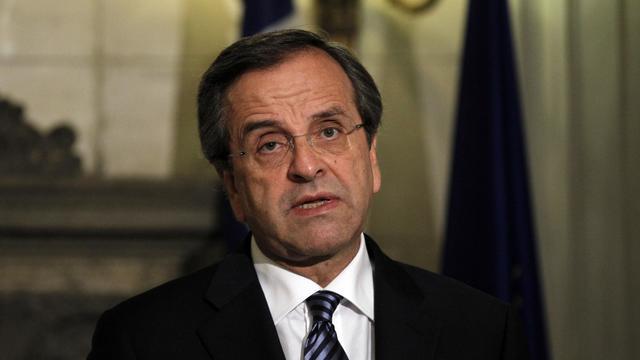 """Le Premier ministre grec, Antonis Samaras, a fixé samedi comme """"priorité"""" à la Grèce un """"rapport positif"""" de la troïka chargée par l'UE et le FMI de veiller à son redressement, pour la maintenir à flot et dans l'euro. [AFP]"""