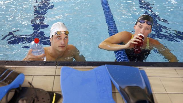 Les nageurs français Yannick Agnel et Camille Muffat à l'entraînement le 14 septembre 2012 à Nice [Valery Hache / AFP]