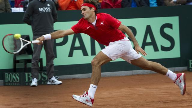 Roger Federer assure le maintien de la Suisse dans le Groupe mondial de la Coupe Davis en battant le Néerlandais Robin Haase, à Amsterdam, le 16 septembre 2012. [Toussaint Kluiters / AFP]