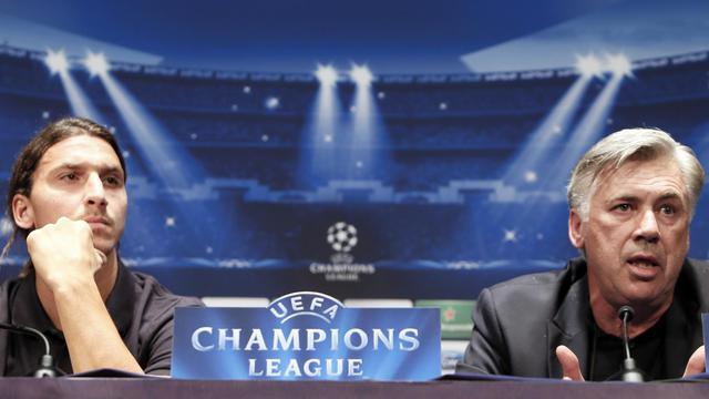 Zlatan Ibrahimovic (g) et l'entraîneur du PSG Carlo Ancelotti en conférence de presse aux Parc des Princes, à Paris, le 17 septembre 2012. [Kenzo Tribouillard / AFP]