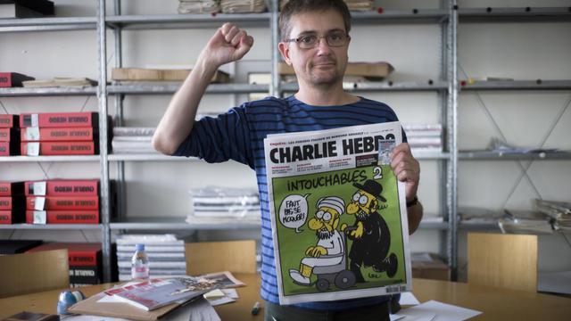 Charb, le patron de Charlie Hebdo, au siège du journal satirique, à Paris, le 19 septembre 2012 [Fred Dufour / AFP]