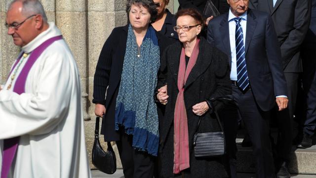 Michel-Edouard Leclerc et sa mère lors des funérailles de son père, Edouard Leclerc, à Landerneau, le 20 septembre 2012 [Fred Tanneau / AFP]