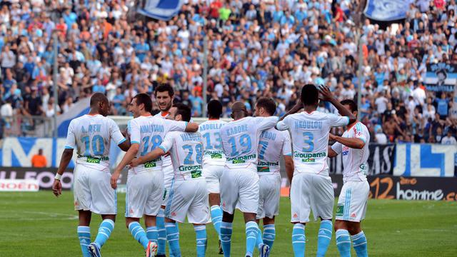 Les joueurs de l'OM fêtent le but de Morgan Amalfitano face à Evian-TG, le 23 septembre 2012 à Marseille [Gérard Julien / AFP]