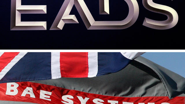 Montage photo avec le logo d'EADS et celui de BAE Systems à côté d'un drapeau britannique [Christof Stache / AFP/Archives]