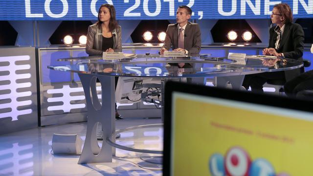 La FDJ présente à la presse la nouvelle livrée du Loto, mardi 2 octobre 2012. [Jacques Demarthon / AFP]
