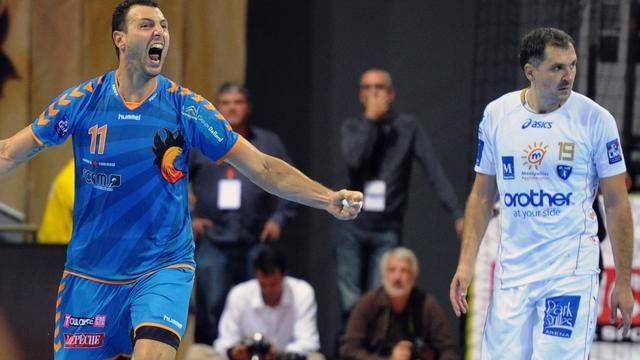 Le Toulousain Jérôme Fernandez (g) exulte après avoir marqué contre Montpellier au Palais des Sports de Toulouse, le 3 octobre 2012. [Pascal Pavani / AFP]