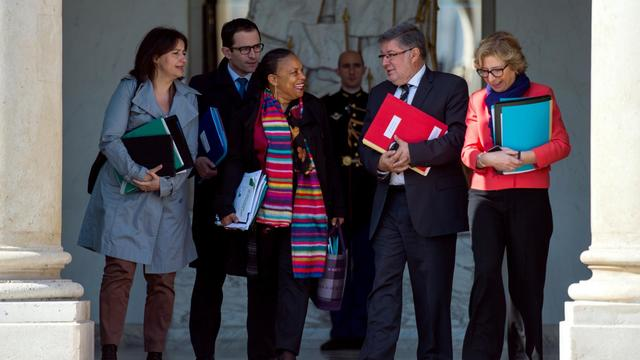 La garde des Sceaux Christiane Taubira (au centre) entourée d'autres ministres à la sortie de l'Elysée, le 22 mai 2013 [Martin Bureau / AFP]