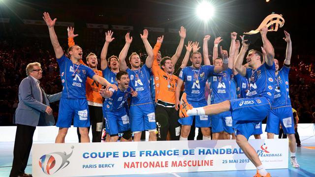 Les handballeurs de Montpellier fêtent leur victoire en Coupe de France, le 25 mai 2013 à Paris-Bercy [Eric Feferberg / AFP]