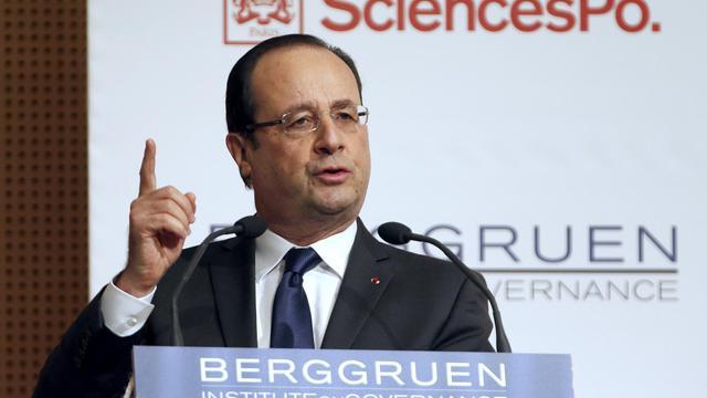 """François Hollande, le 28 mai 2013 lors d'un colloque à Sciences Po Paris sur le thème """"Europe : les prochaines étapes"""" [Charles Platiau / Pool/AFP]"""