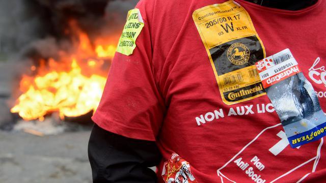 Un salarié de Goodyear à Nanterre, en région parisienne, le 3 juin 2013 [Denis Charlet / AFP]