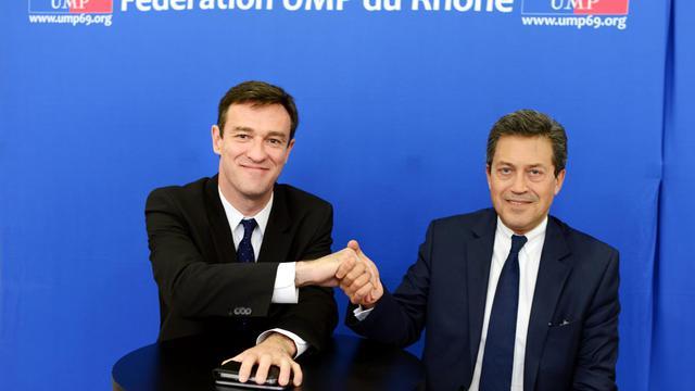 Le député Georges Fenech (d) et le leader de l'opposition au conseil municipal de Lyon, Michel Havard, le 4 juin 2013 à Lyon [Philippe Merle / AFP]