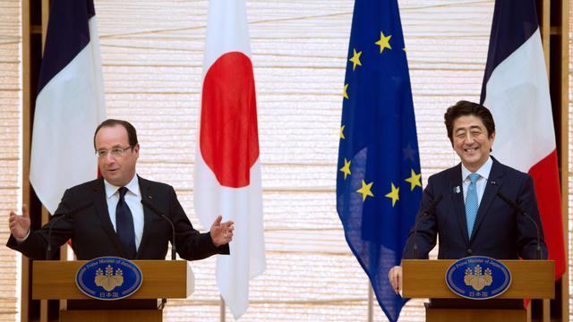 Le président français François Hollande et le Premier ministre japonais Shinzo Abe, le 7 juin 2013 à Tokyo [Bertrand Langlois / AFP]