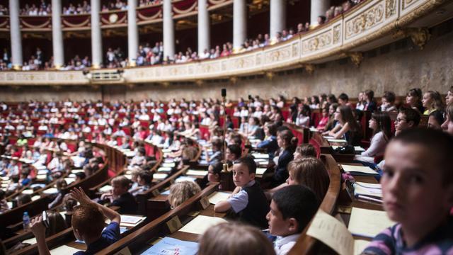 Des écoliers à l'Assemblée nationale le 8 juin 2013 à Paris [Fred Dufour / AFP]