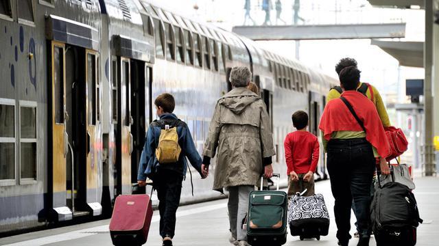 Des passagers le 13 juin 2013 à la gare de Lille [Philippe Huguen / AFP]