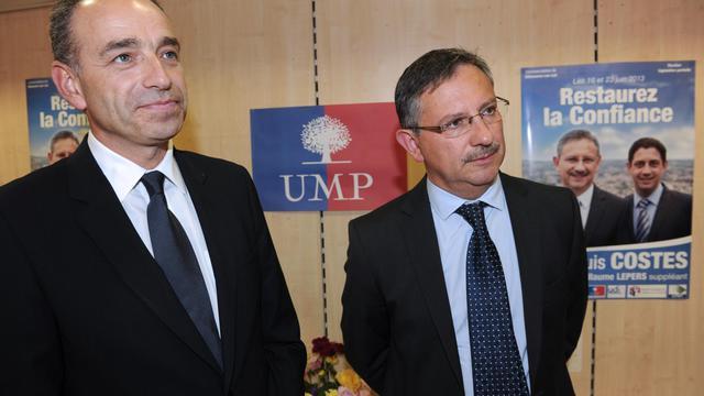 Jean-François Copé (g) et Jean-Louis Costes, le 14 juin 2013 à Villeneuve-sur-Lot [Mehdi Fedouach / AFP]