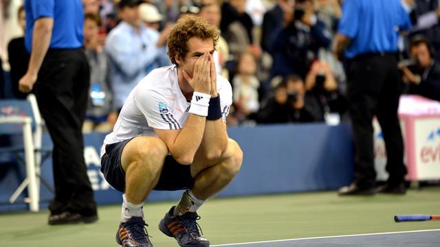 """Andy Murray est enfin entré dans le club des vainqueurs de Grand Chelem, où l'attendaient Roger Federer, Rafael Nadal et Novak Djokovic, trouvant sa place pour de bon dans le """"Big Four"""" mondial [AFP]"""