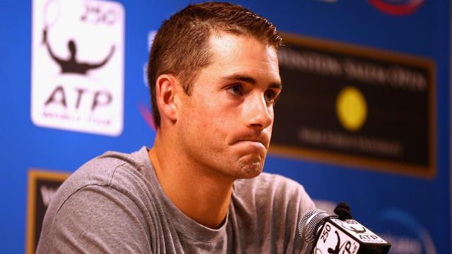 L'Américain John Isner annonce son forfait avant les quarts de finale du tournoi ATP de Winston-Salem (Caroline du Nord), le 21 août 2014 [Streeter Lecka / Getty/AFP]