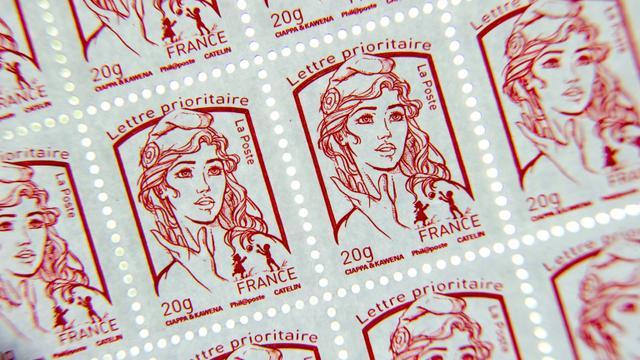 Un rouleau de timbres à l'effigie de Marianne, timbre officiel de la République Française le 1er octobre 2014 à Nieppe au Nord de la France [PHILIPPE HUGUEN / AFP/Archives]