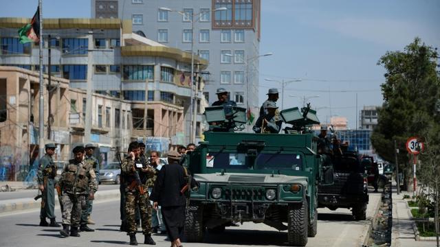 Les forces de sécurité afghanes lors d'une précédente attaque à Mazar-i-sharif, en Afghanistan, le 9 avril 2015 [FARSHAD USYAN / AFP/Archives]