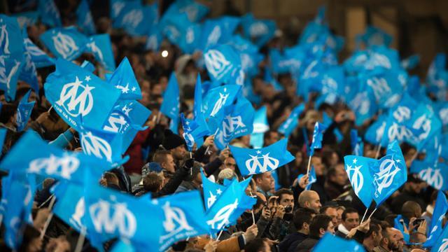 Des supporters marseillais lors d'un match contre Monaco, le 29 novembre 2015 au Vélodrome [BERTRAND LANGLOIS / AFP/Archives]