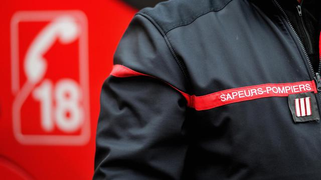 Un sapeur-pompier en uniforme [Philippe Huguen / AFP/Archives]