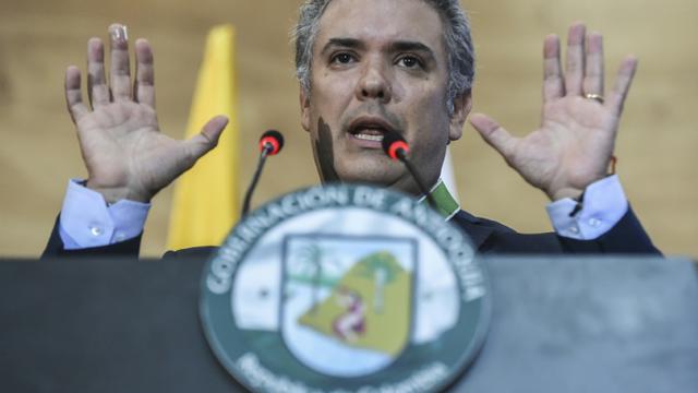 """Le président-élu colombien Ivan Duque pendant la présentation de son livre """"L'Archéologie de mon père"""" à Medellin, en Colombie le 10 juillet 2018 [JOAQUIN SARMIENTO / AFP]"""