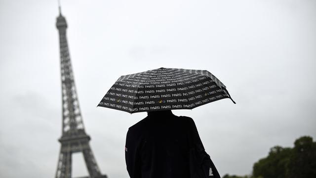 Jour de pluie à Paris le 8 août 2014 [Lionel Bonaventure / AFP/Archives]