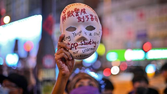 Hong Kong's leader outlawed face coverings at protests, invoking colonial-era emergency powers not used for half a century [Philip FONG / AFP]